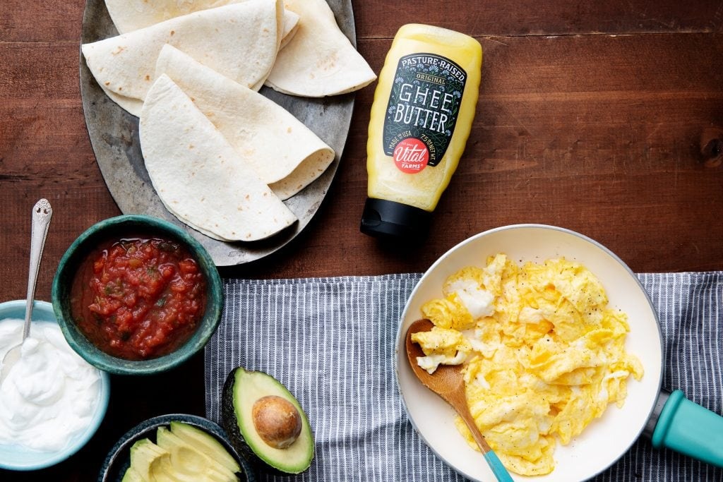 Vital Farms Pasture Raised Ghee in a squeeze bottle with taco fixings and scrambled eggs