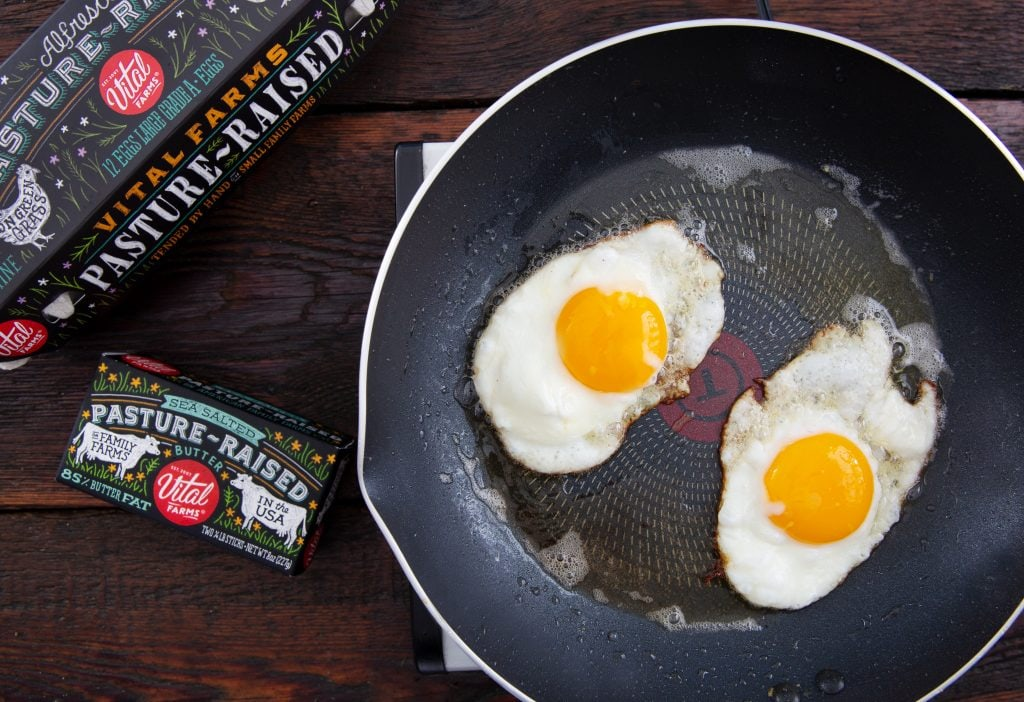 Crispy fried eggs in a skillet