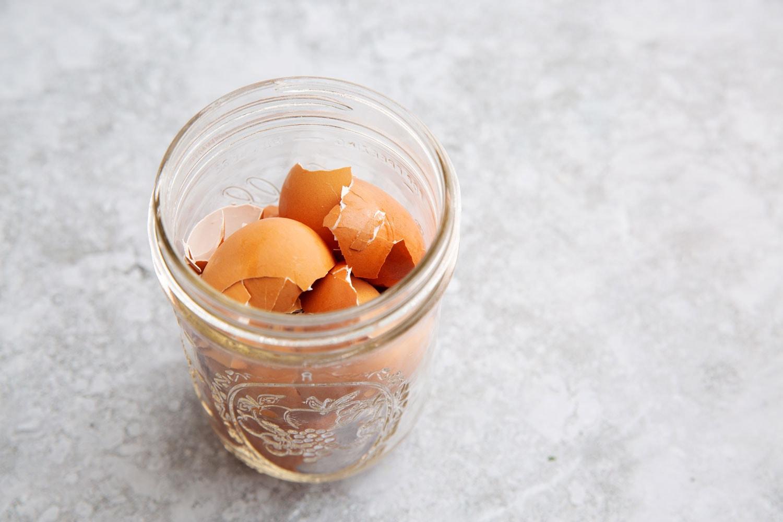 Broken eggshells in a mason jar.