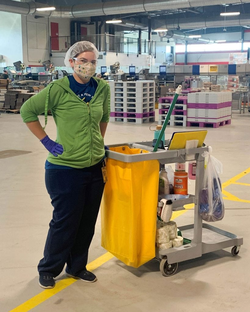 Portrait of Lendsi Armstrong with her cleaning gear at Vital Farms Egg Central Station