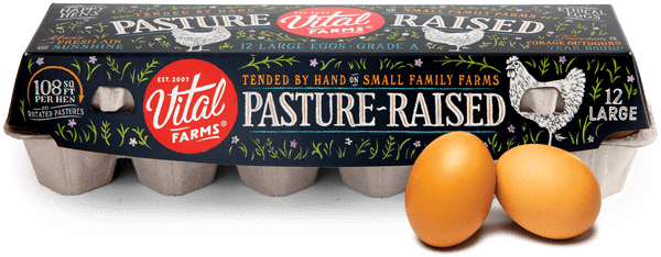 A carton of Vital Farms Pasture Raised eggs and a couple eggs in front.